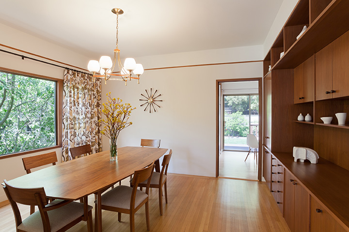 Mid-Century Modern Dining Room with Walnut Cabinetry