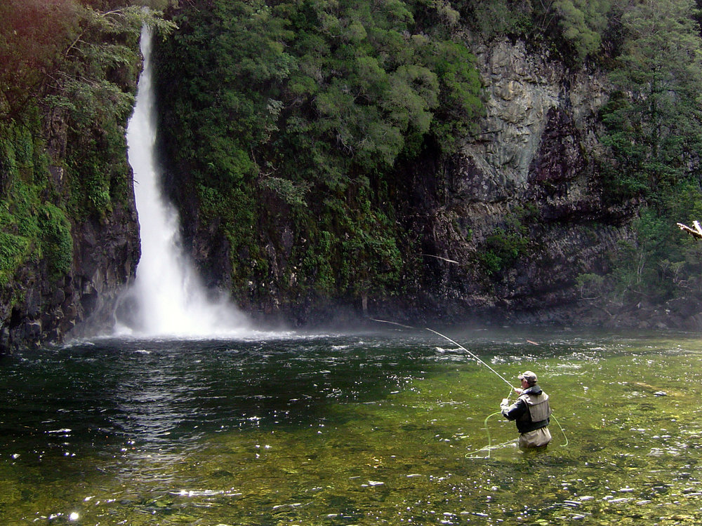 Fisherman with waterfall in background.jpg
