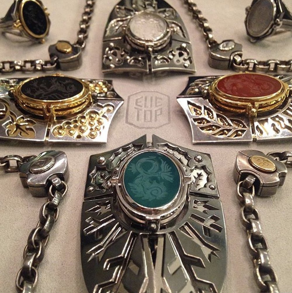 Four shield pendants representing the four elements / Photo: @elietopofficial