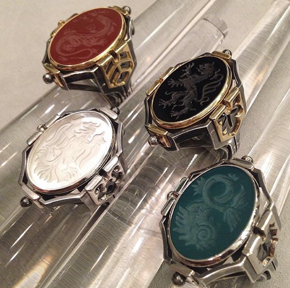 Rings fitted with cornaline, onyx, rock crystal and green agate stones to represent each of the four elements.