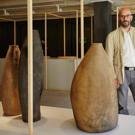 Ernst Gamperl with his 'Tree of Life 2' oak sculptures