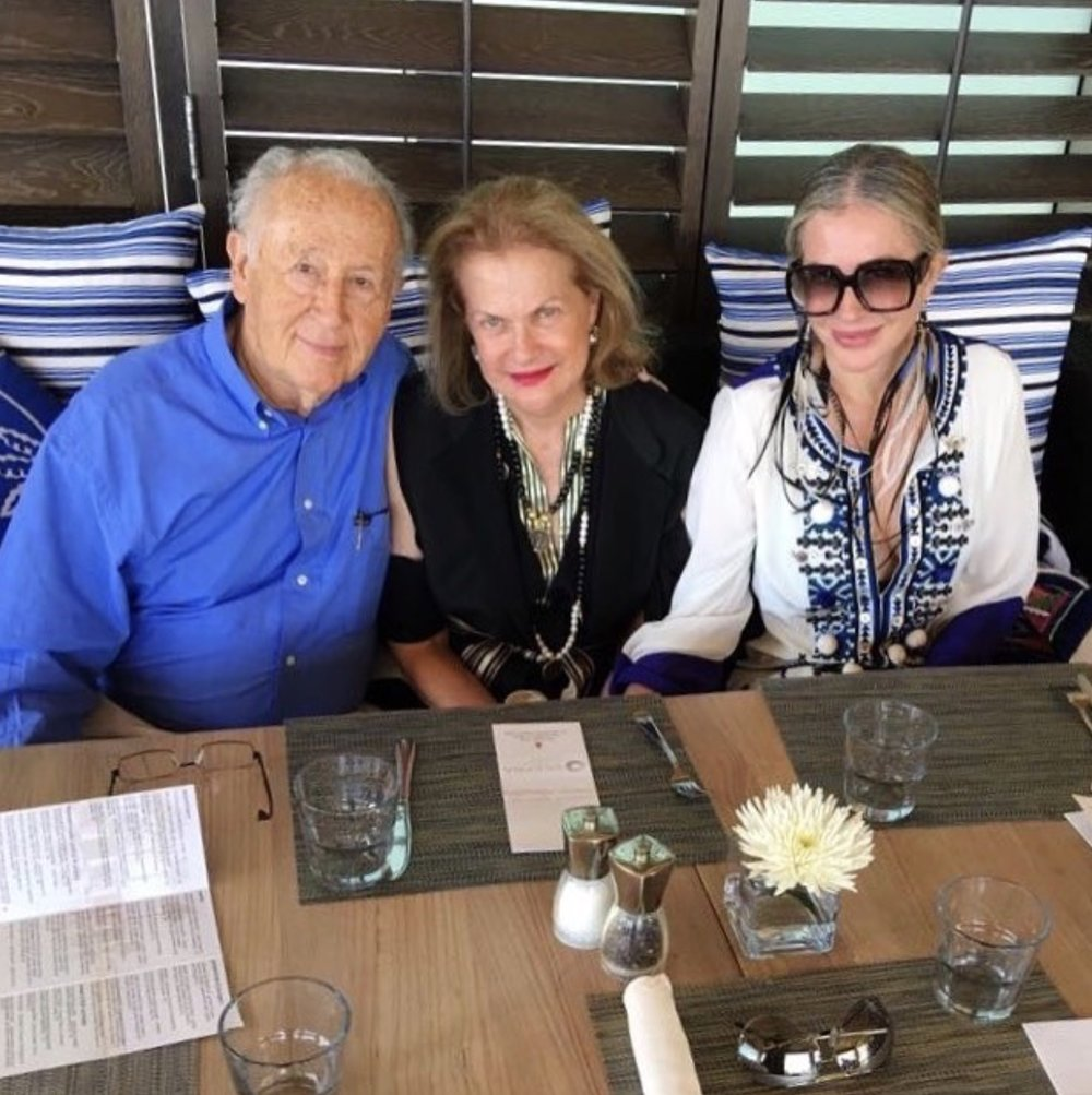 Carmen pictured with her parents this summer in Miami.