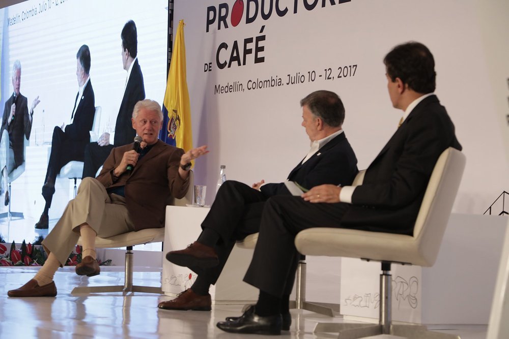 Former US President Bill Clinton joins Colombia's President Juan Manuel Santos on stage at the first World Coffee Producers Forum in Medellin.