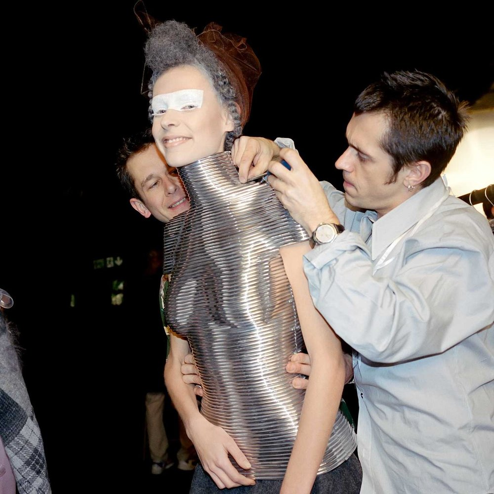 Fitting the coiled corset to model Laura Morgan before Alexander McQueen's AW 1999 show.