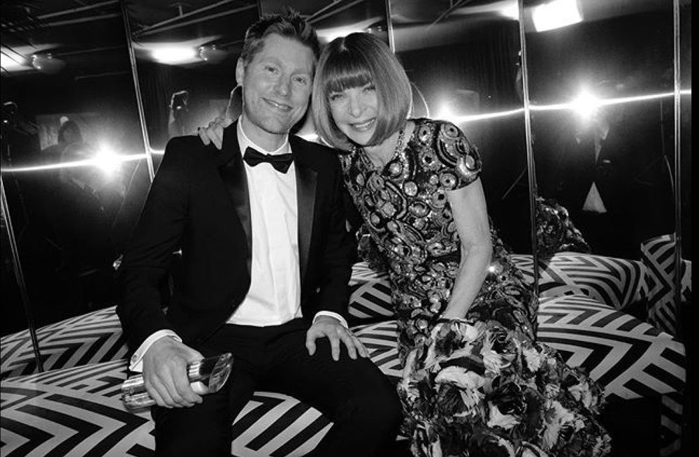 Burberry's Christopher Bailey backstage in the winner's room with Editor-in-Chief of Vogue Anna Wintour.
