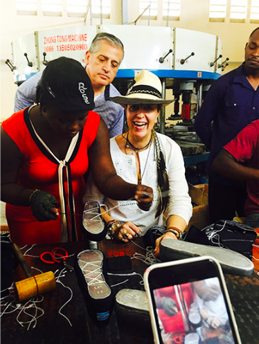Founder Stephanie von Watzdorf with local artisans during a trip to Haiti.