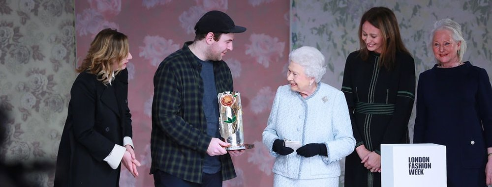 Richard Quinn receiving the Queen Elizabeth II Award For British Design from Her Majesty / Photo: BFC