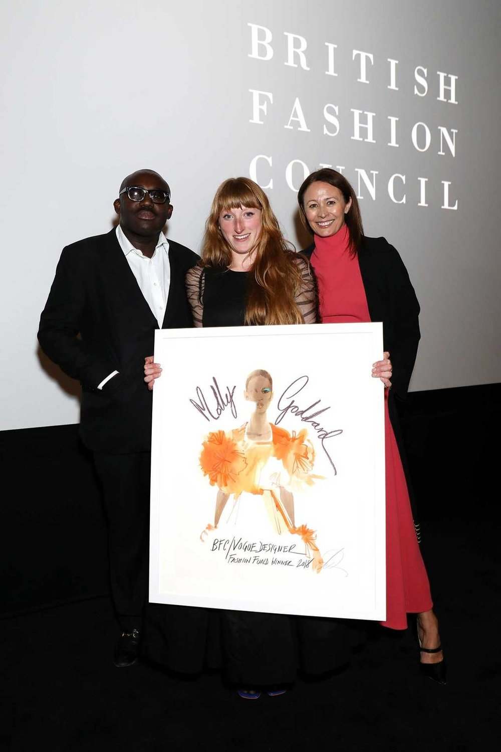 Award-winner Molly Goddard with British Vogue's editor-in-chief Edward Enninful and the BFC's Chief Executive Caroline Rush / Photo: BFC