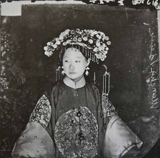 A Manchu Bride, Beijing (1871 – 72) / The Wellcome Library, London.