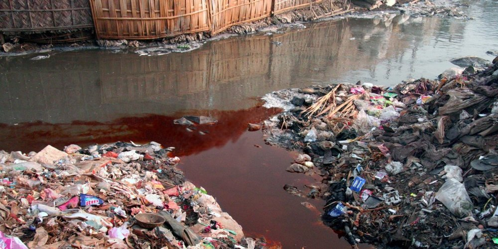 Magenta-colored wastewater spills into a river in China / Photo: RiverBlue.
