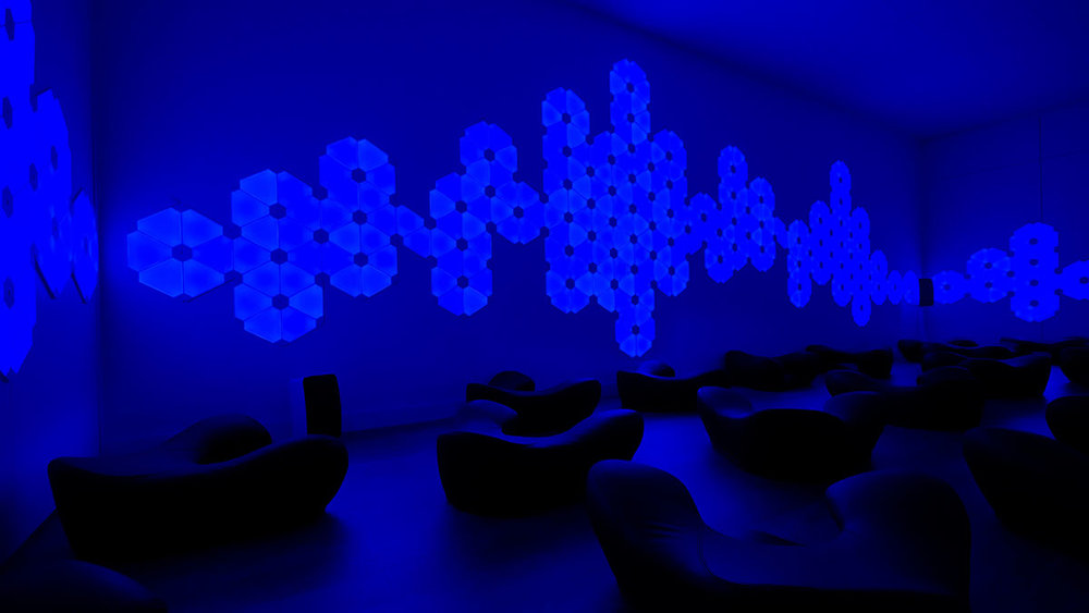 A Brain Gym studio bathed in soothing, color-changing lighting installations.