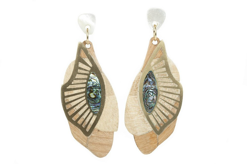 Abalone shells are given to local eco-jewelry brand niiin for use in its designs, including these Zayah Wing Stud Earrings.