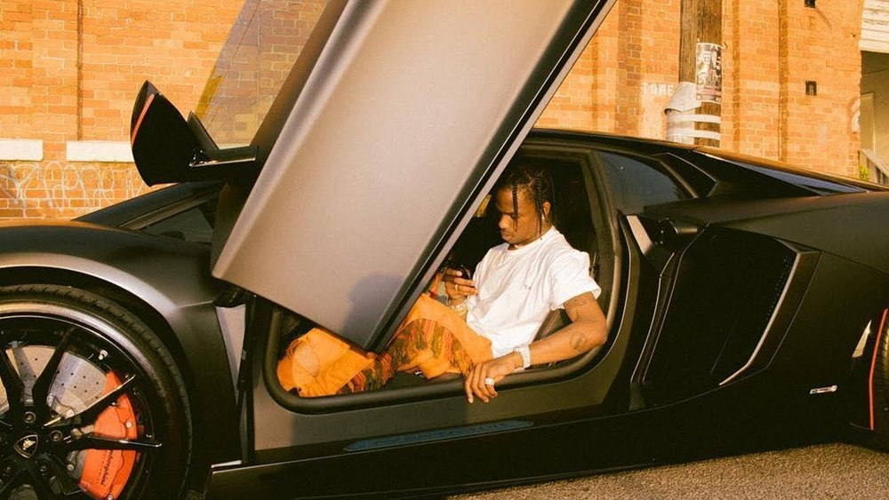 Travis Scott photographed in a pair of Alchemist's 'Know You Rider' joggers.