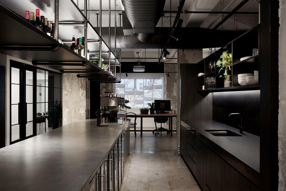 Woods Bagot's self-designed New York studio features exposed concrete walls.