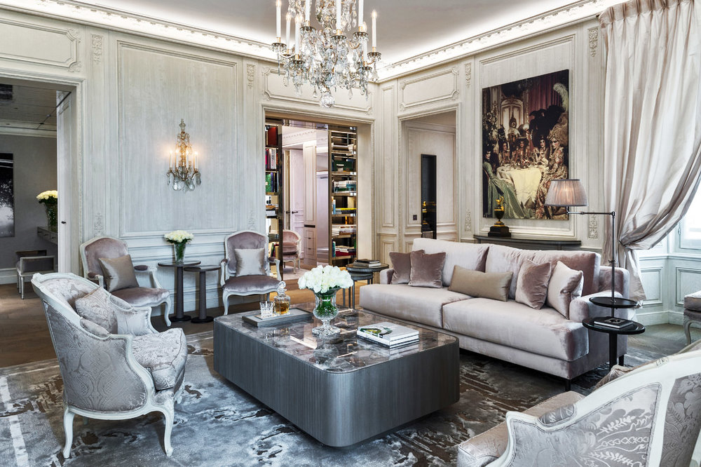 "The gray-mauve eggshell interiors of the Karl Lagerfeld designed suites reflect ""the silvery light of Paris."""