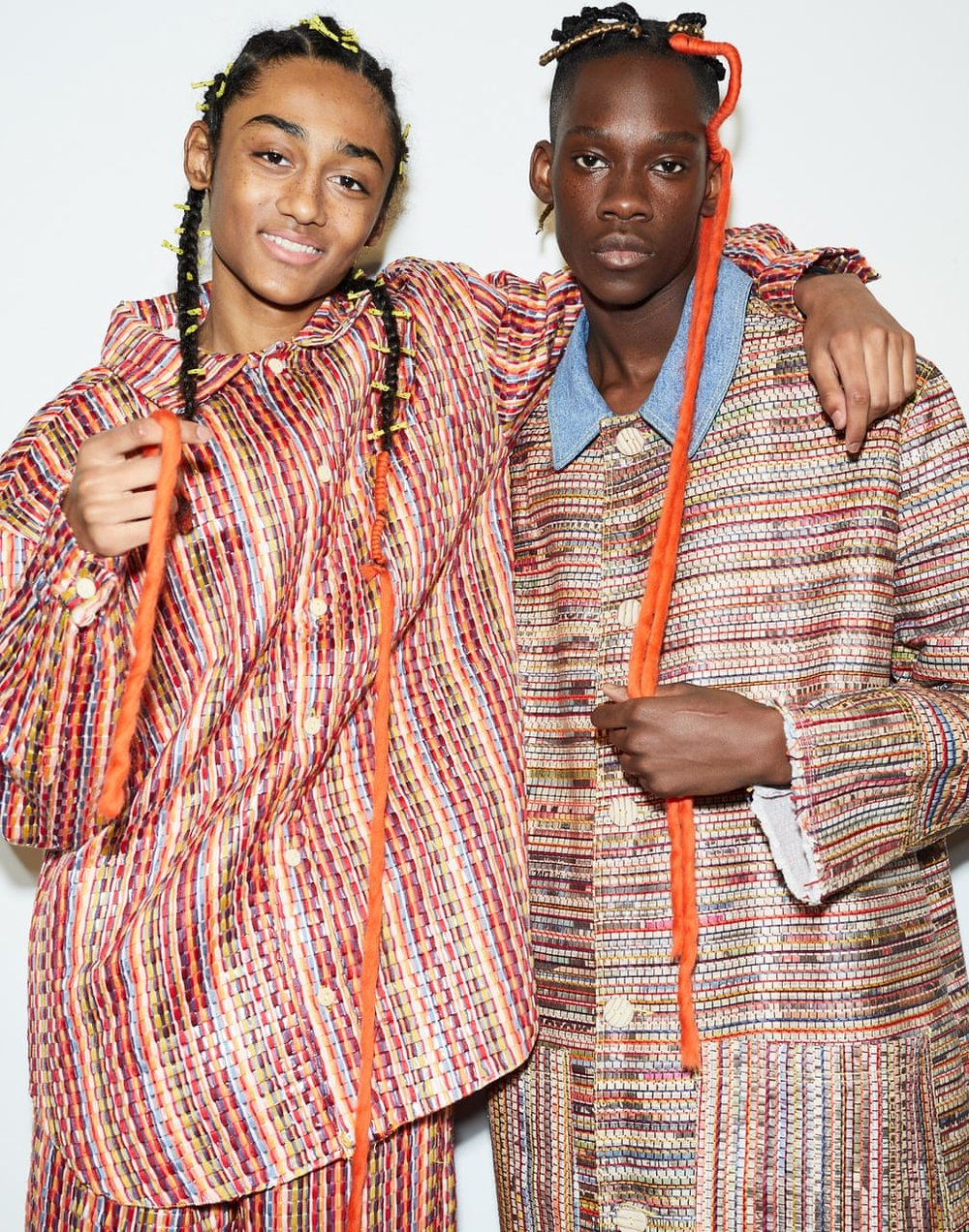 Models wearing coats and trousers made in collaboration with Italy's San Patrignano drug rehabilitation center / Photo: Jamie Baker.