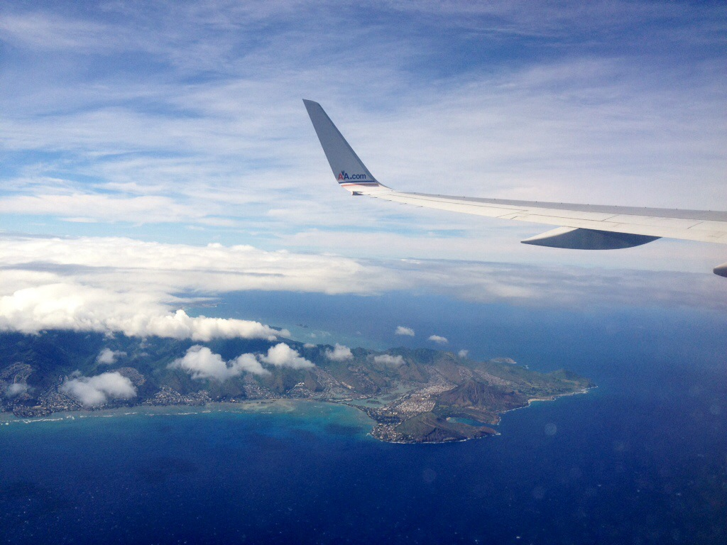 Aircraft wing shot over Oahu