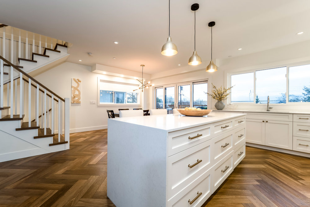 Parker Street - The open living area and kitchen, master staircase, and herringbone hardwood floors truly add to the final product.