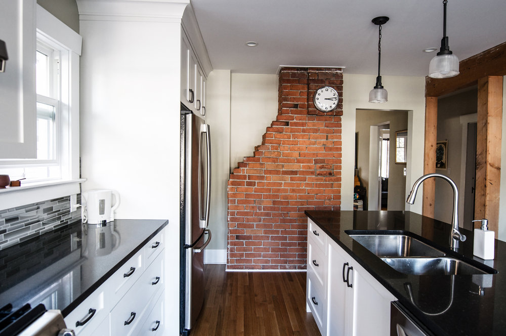 Wilson Kitchen - Modern and elegantly nostalgic - The timeless brick chimney highlights this kitchen renovation.