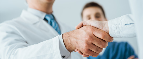 Two healthcare professionals shaking hands