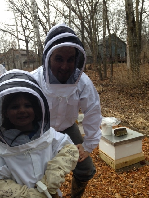 Father and Daughter time tucked tight in bee suits!