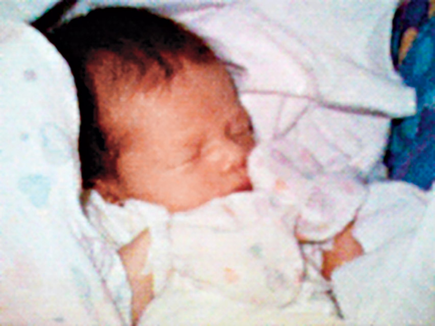 "The First Cell Phone Picture  was this photograph of newborn, Sophie Kahn, and was labeled as having ""Possible"" violence."
