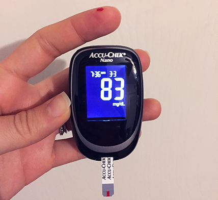Learning about glucose management by observing how to use a blood glucose monitor.