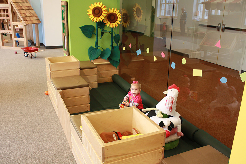 Safe space for infants. Mats, mirrors and handlebars to help crawlers stand up.