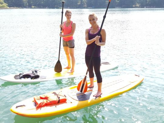 635930531294065987-Discover-Wisconsin-host-Mariah-Haberman-and-friend-take-on-standup-paddle-board-yoga-in-Waupaca.jpg