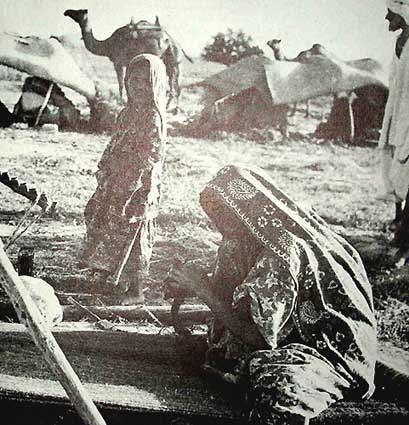 Baluch nomadic tribespeople weaving rugs circa 1900