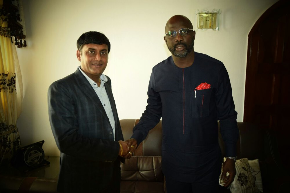 Ambassador George Weah and Nirav Tripathi at the signing of their partnership agreement in Monrovia in November 2016