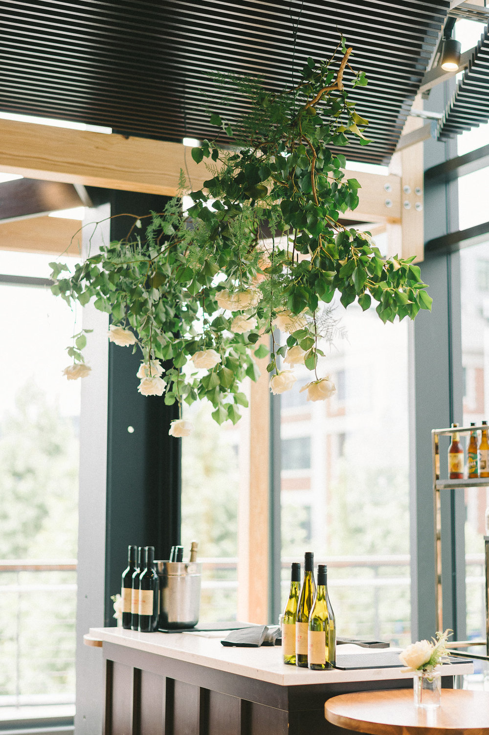 Ivy, plums and white roses was all it took to make something special and dramatic. Photo by  Liz Fogarty