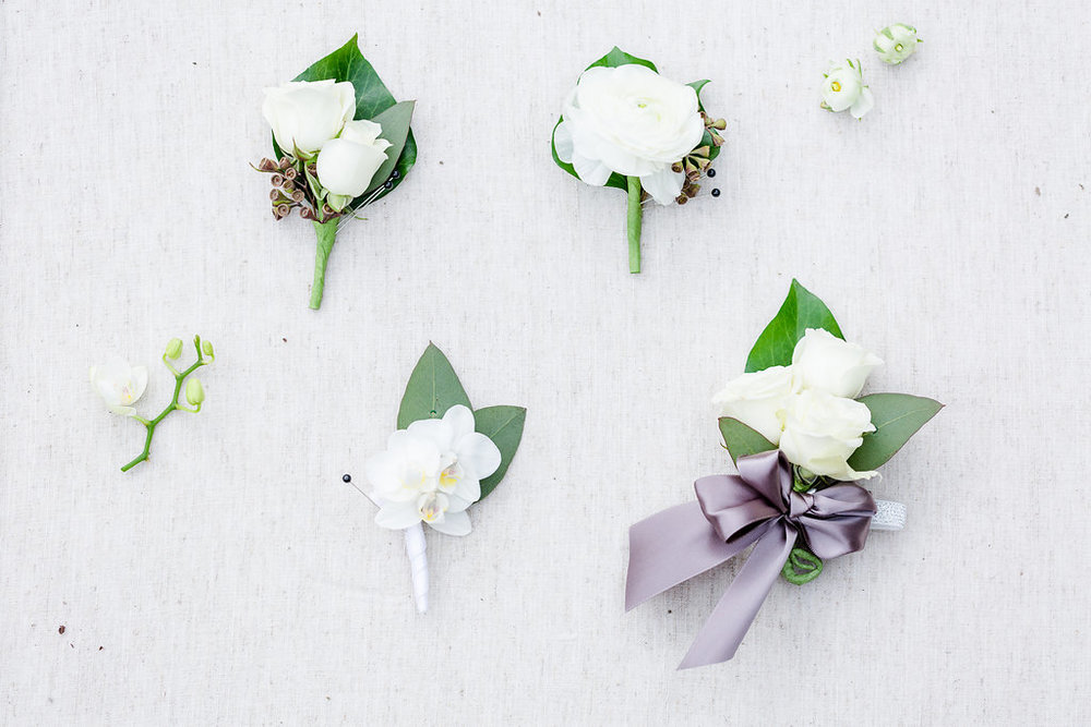 How the boutonnieres compare with a traditional wrist corsage. Rachael E.H. Photography