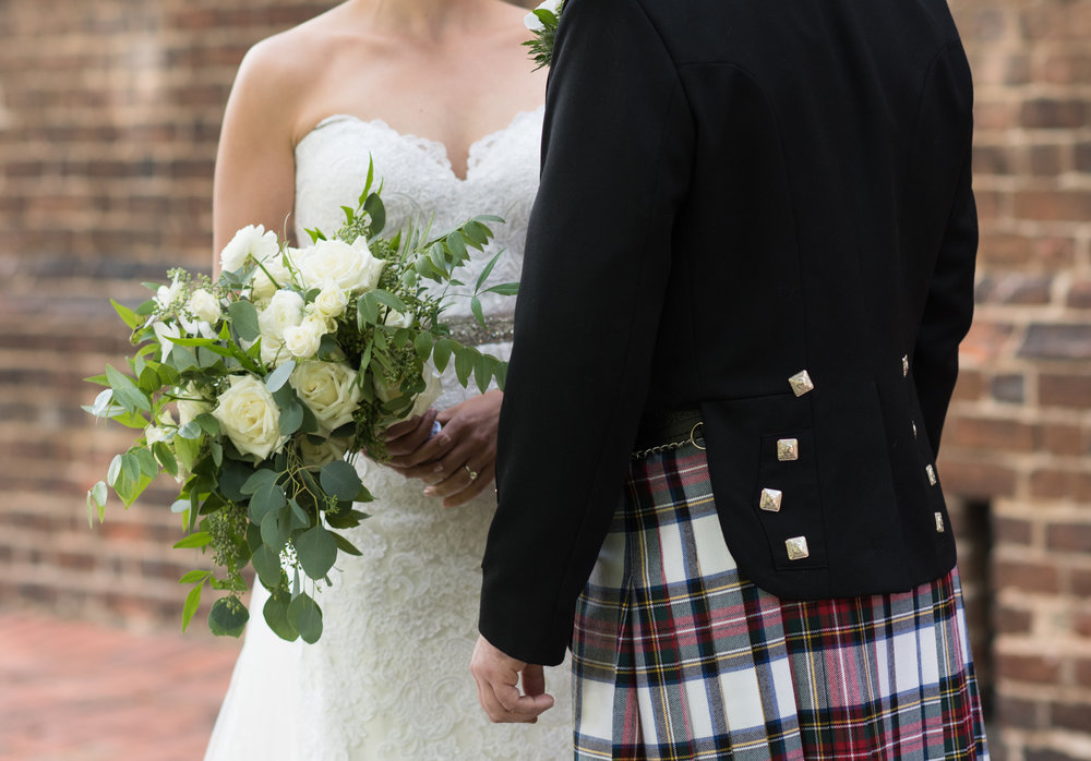 Sarah's airy bouquet in greens and whites was a perfect match to Keith's tartan kilt.  The bouquet included white roses and orchids, blooming clematis vine and greenery.