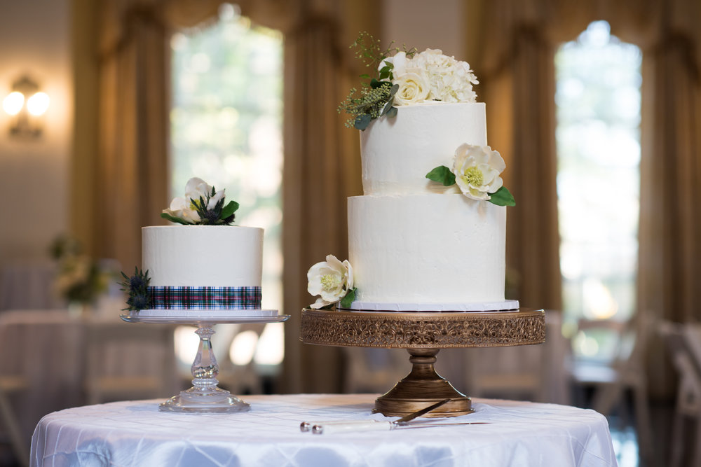 Elegant bride and groom cakes accented with fresh flowers by   Morgan Phillips Cakes  .