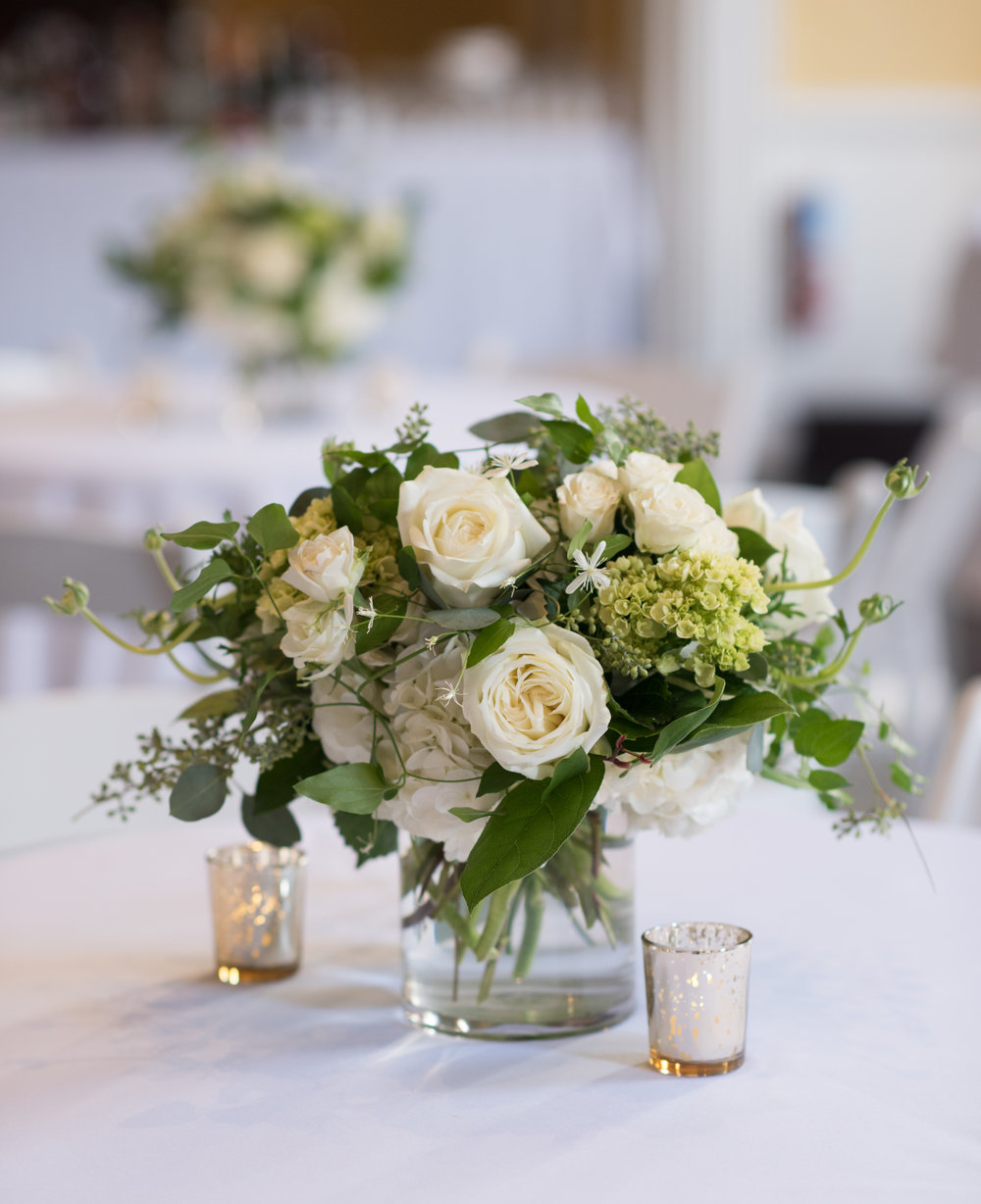 More classic greens and whites for the table arrangements.