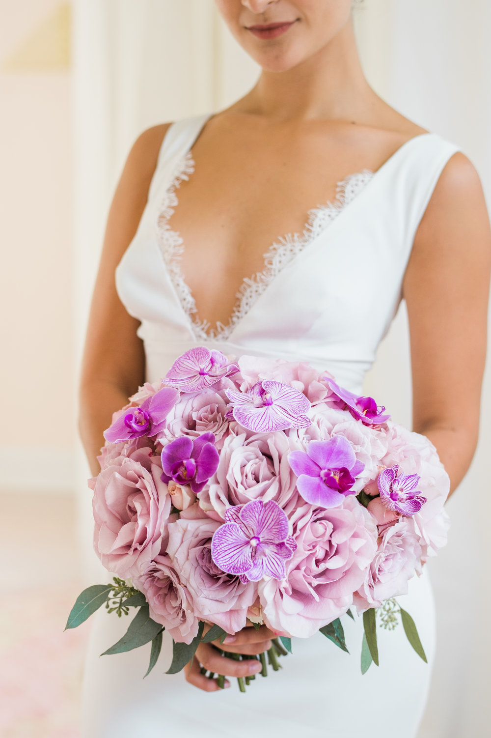 Garden Roses for days accented with Phalaenopsis.