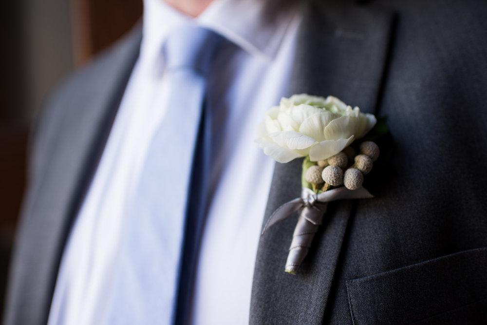 Atelier Ashley Flowers + Erin Tetterton Photography + White Ranunculus Boutineer + Grey  Brunia Berries