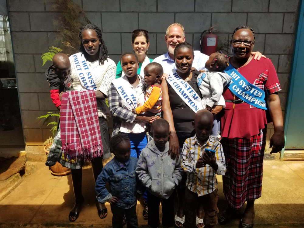 Mothers and babies with Brad Gautney in Kenya. | Photo courtesy of Global Health Innovations.