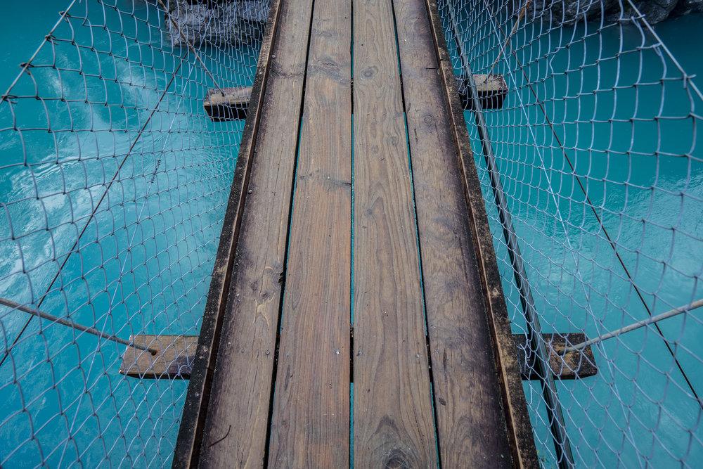 Very unstable swing bridge over the Hokitika River.