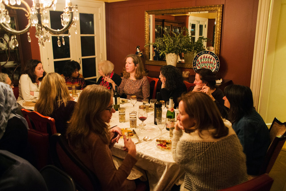 Kate McCaffrey, gesturing center, was the host of a Syria Supper Club dinner in Maplewood, N.J.CreditTess Mayer for The New York Times