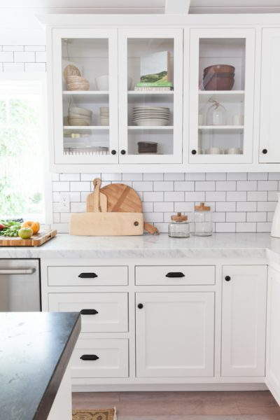 NEUTRAL BACKSPLASH - A simple neutral backsplash with white shaker cabinets - yes please! We're fond of a classic subway tile, or even a marble subway for the Modern Farmhouse look.Image by Mindy Gayer Design