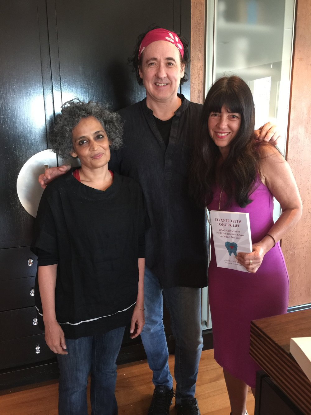 Dr Garcia with patient John Cusack (actor, producer and  screenwriter) and world renowned author Arundhati Roy who are co-authors of the recent book Things That Can and Cannot be Said