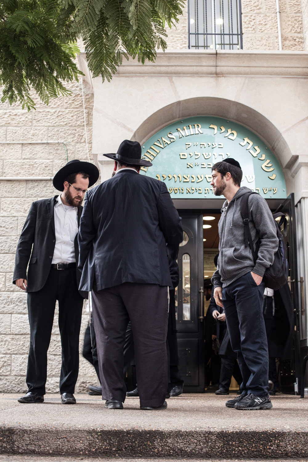 Unexpected encounter with old classmates in front of his former Yeshiva - a religious school for male Ultra-Orthodox  Mea Shearim, Jerusalem, January 2016