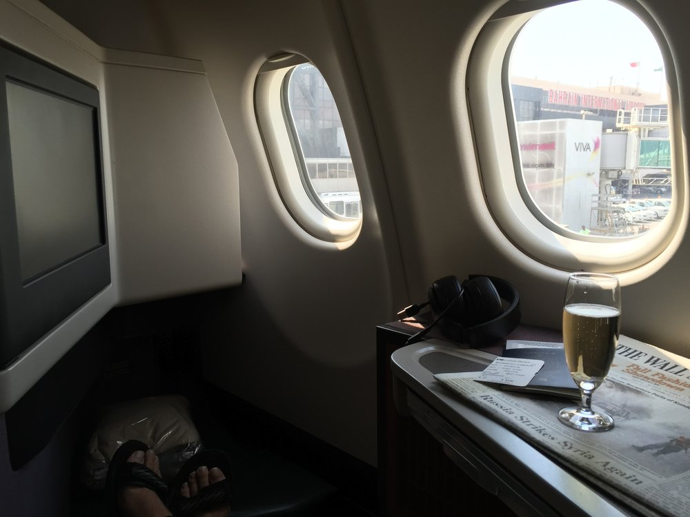 """An aperitif prior to push back on board CX746 from BAH --> HKG. """"> An aperitif prior to push back on board CX746 from BAH –> HKG.</p> <p><strong>#5nights5cities</strong></p> <p>My upcoming whirlwind trip is mostly based on points. I am using Asia Miles to book business class on Qatar Airways from Hong Kong to Warsaw with an overnight layover in Doha. I have flown Qatar twice before, on a round-trip to Munich in 2012, and I can't wait to sample the hospitality on board the <a href="""