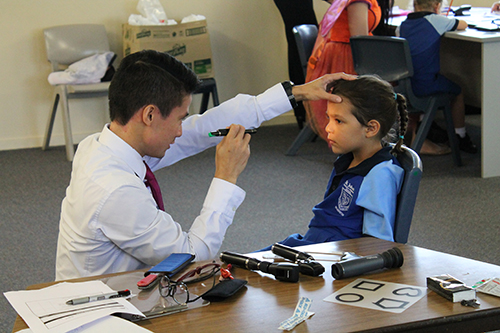 Westfund Eye Care Optometrist Ronald Nguyen with St John's student Marla....jpg