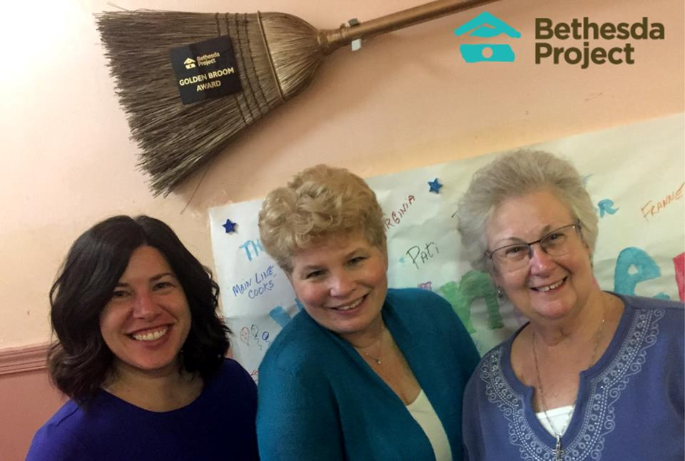 Tina Pagotto, Michelle Marlin & Kathleen Sonnie proudly hang the Golden Broom at Bethesda Spruce!