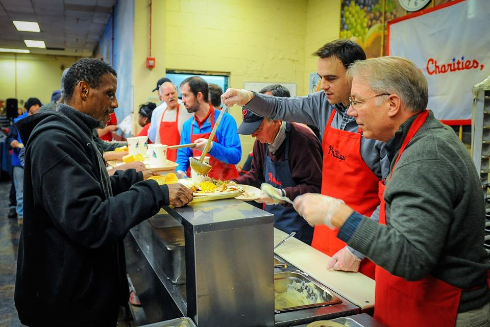 Phillies front office team serve holiday meals to over 200 guests at Our Brothers' Place