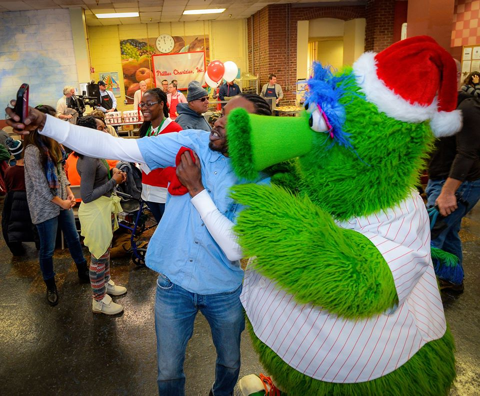 Our Brothers' Place guest Kenneth gets a selfie with the Phanatic!