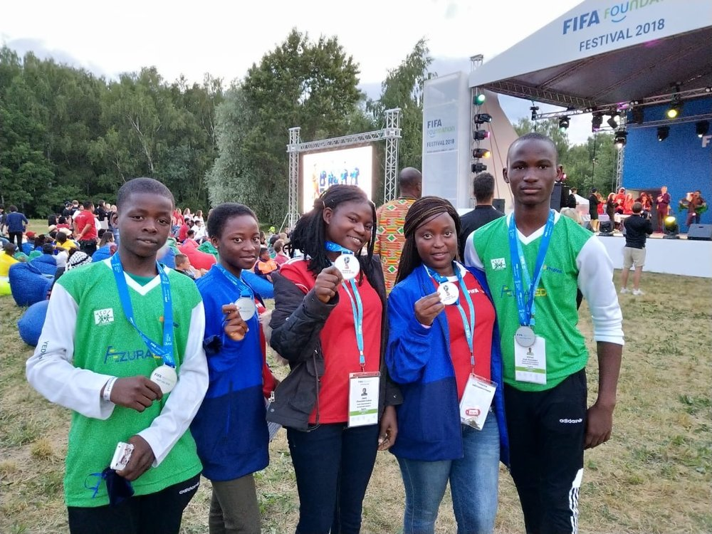 The Azura-Edo sponsored team picking up their medals at the FIFA Festival, Moscow